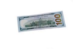 Cientos billetes de dólar aislados en el fondo blanco Imagen de archivo