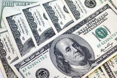 Cientos billetes de dólar para un fondo Fotografía de archivo libre de regalías