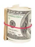 Cientos billetes de dólar rodados para arriba con el rubberband Fotografía de archivo