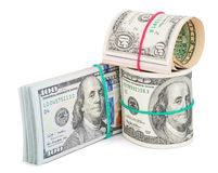 Cientos billetes de dólar rodados para arriba con el rubberband Fotos de archivo libres de regalías