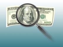 Cientos billetes de dólar y lupas Imagen de archivo libre de regalías