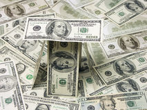 Cientos casas de la cuenta de dólar Imágenes de archivo libres de regalías