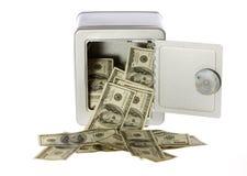 Cientos cuentas de dólar en caja fuerte abierta Fotos de archivo