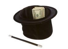 Cientos cuentas de dólar en un sombrero mágico con la varita Fotografía de archivo