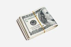 Cientos cuentas de dólar llevadas a cabo con la goma Imágenes de archivo libres de regalías
