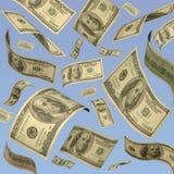 Cientos cuentas de dólar que flotan contra el cielo azul. Fotografía de archivo