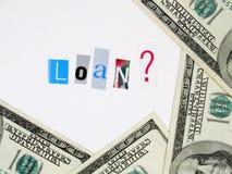 Cientos cuentas de dólar y concepto del préstamo Foto de archivo