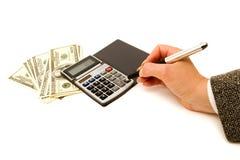 Cientos cuentas y calculadora de dólar Foto de archivo