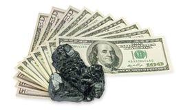 Cientos dólares de billete de banco y carbón crudo Imagen de archivo