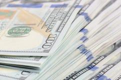 Cientos dólares de fondo de los billetes de banco Imágenes de archivo libres de regalías