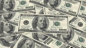 Cientos dólares de pila y retrato Benjamin Franklin del billete de banco en billete de banco del dinero de los E.E.U.U. fotos de archivo