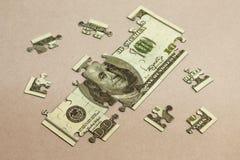 Cientos dólares de rompecabezas Concepto de la foto Fotos de archivo libres de regalías