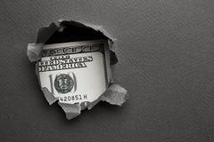 Cientos dólares en agujero Fotos de archivo libres de regalías