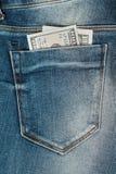 cientos dólares en el bolsillo de los vaqueros Imagen de archivo libre de regalías