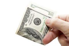 Cientos dólares en manos Fotografía de archivo libre de regalías