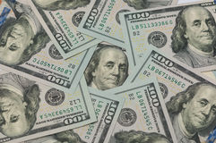 Cientos dólares en un círculo Foto de archivo libre de regalías