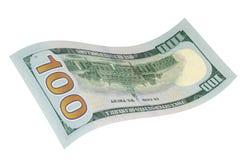 Cientos dólares en un fondo blanco Imágenes de archivo libres de regalías