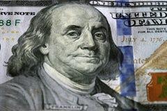 Cientos dólares Foco selectivo en los ojos de Benjamin Franklin Fotos de archivo libres de regalías