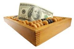 Cientos dólares y calculadora vieja Foto de archivo