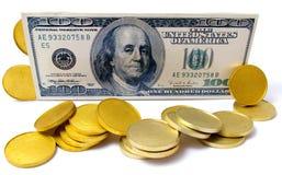 Cientos dólares y oros Imagenes de archivo