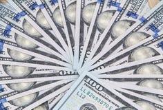 Cientos dólares en abanico Imagen de archivo libre de regalías