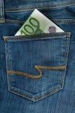 Cientos euros en el bolsillo de los vaqueros Fotografía de archivo libre de regalías