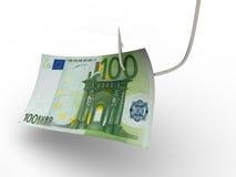 Cientos euros en el gancho de leva de pesca Foto de archivo