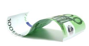 Cientos euros en un fondo blanco imagen de archivo