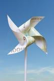 Cientos molinoes de viento del juguete del euro Imagenes de archivo