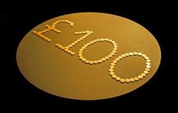 Cientos monedas de libra Imagen de archivo libre de regalías