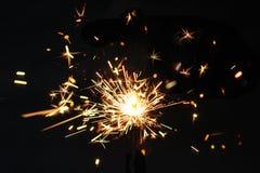 Cierge magique de partie de Noël ou de nouvelle année sur le fond noir Festi Images stock