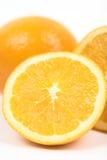 Cierre alto de las mitades anaranjadas Foto de archivo libre de regalías
