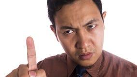 Cierre asiático divertido del hombre encima de la expresión enojada fotografía de archivo libre de regalías