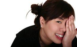Cierre asiático feliz de la muchacha para arriba Fotos de archivo libres de regalías