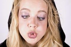 Cierre bizco de la muchacha de la expresión para arriba Foto de archivo libre de regalías