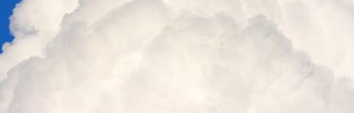 Cierre blanco de la nube para arriba Fotografía de archivo