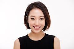 Cierre bonito asiático joven de la mujer de negocios encima del retrato. Imagenes de archivo
