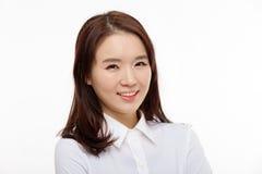 Cierre bonito asiático joven de la mujer de negocios encima del retrato Foto de archivo libre de regalías