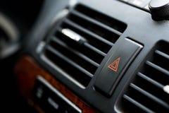 Cierre con botón de la emergencia encima del tiro macro en el coche japonés fotografía de archivo libre de regalías