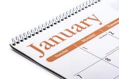 Cierre de escritorio de enero del calendario para arriba en el fondo blanco Fotografía de archivo libre de regalías
