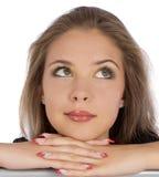 Cierre de la cara de la muchacha del retrato para arriba que mira en blanco Foto de archivo libre de regalías