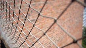 Cierre de la cerca de la malla para arriba metrajes