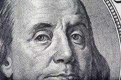 Cierre de la macro de la cara de Ben Franklin para arriba Imagen de archivo libre de regalías