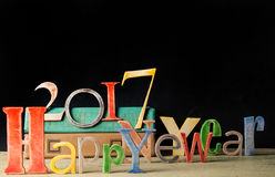 Cierre de madera multicolor de la Feliz Año Nuevo de la inscripción para arriba Imagen de archivo