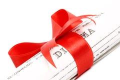 Cierre de un diploma Fotos de archivo libres de regalías