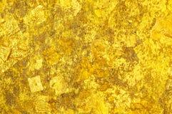 Cierre del brillo de Goldden encima de la textura del fondo Foto de archivo libre de regalías