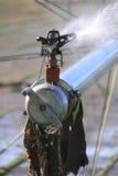 Cierre del extremo en boca industrial de la irrigación de la granja Imagenes de archivo