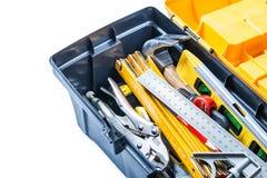 Cierre encima de las herramientas de la visión en la caja de herramientas aislada foto de archivo