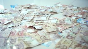 Cierre encima del fondo tailandés del primer de los billetes de banco del dinero, dinero para el negocio, monedas de Tailandia 10 almacen de metraje de vídeo