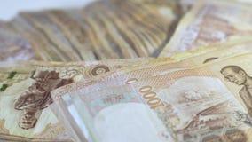 Cierre encima del fondo tailand?s del primer de los billetes de banco del dinero, dinero para el negocio, monedas de Tailandia 10 almacen de metraje de vídeo
